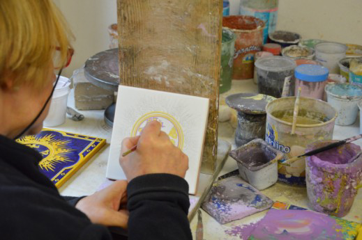The Holy Name Plaques are produced by a family-run ceramic art studio in Deruta, Italy .